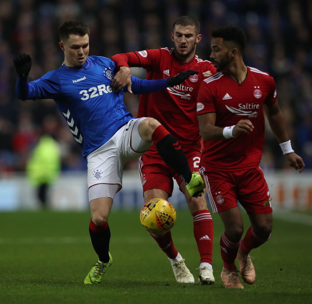 GLASGOW, SCOTLAND - DECEMBER 05: Glenn Middleton of Rangers vies with Dominic Ball of Aberdeen during the Scottish Ladbrokes Premiership match between Rangers and Aberdeen at Ibrox Stadium on December 5, 2018 in Glasgow, Scotland.