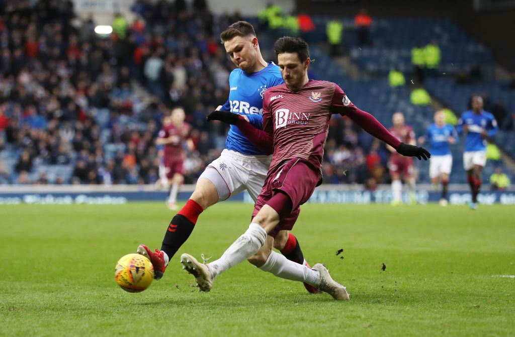 GLASGOW, SCOTLAND - FEBRUARY 16: Glenn Middleton of Rangers vies with Scott Tanser of St Johnstone during the Ladbrookes Scottish Premiership match between Rangers and St Johnstone at Ibrox Stadium on February 16, 2019 in Glasgow, Scotland.