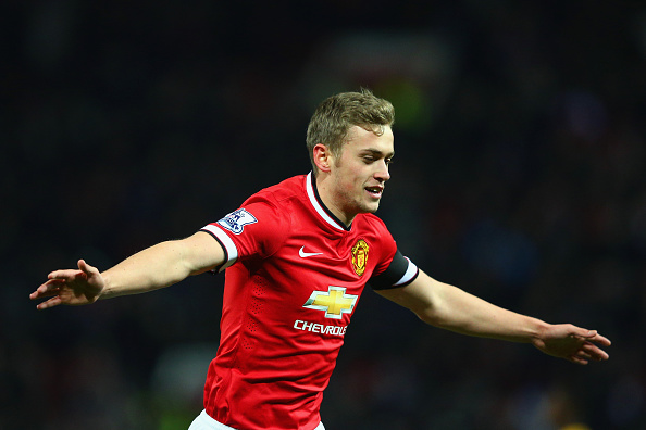 MANCHESTER, ENGLAND - FEBRUARY 03: James Wilson of Manchester United celebrates scoring their third goal during the FA Cup Fourth round replay match between Manchester United and Cambridge United at Old Trafford on February 3, 2015 in Manchester, England.