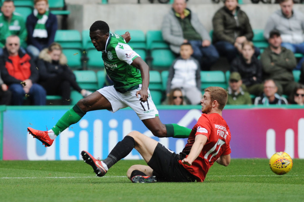 EDINBURGH, SCOTLAND - SEPTEMBER 15: Thomas Agyepong of Hibernian FC is dispossessed by Stuart Findlay (R) of Kilmarnock FC during the Scottish Ladbrokes Premiership match between Hibernian and Kilmarnock at Easter Road on September 15, 2018 in Edinburgh, United Kingdom.