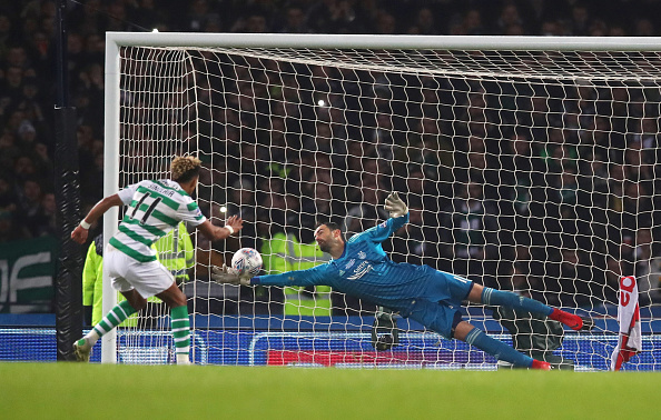 GLASGOW, SCOTLAND - DECEMBER 02: Joe Lewis of Aberdeen saves a penalty from Scott Sinclair of Celtic during the Betfred Cup Final between Celtic and Aberdeen at Hampden Park on December 2, 2018 in Glasgow, Scotland.