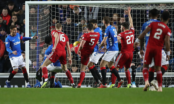 GLASGOW, SCOTLAND - DECEMBER 05: Scott McKenna of Aberdeen scores the opening goal during the Scottish Ladbrokes Premiership match between Rangers and Aberdeen at Ibrox Stadium on December 5, 2018 in Glasgow, Scotland.