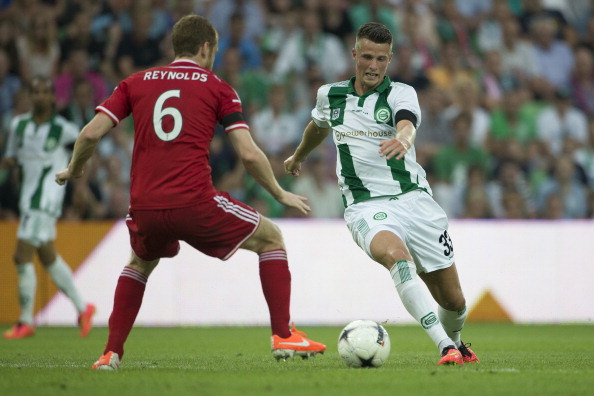(L-R), Mark Reynolds of Aberdeen FC, Hans Hateboer of FC Groningen, during the Europa League match between FC Groningen and Aberdeen FC on july 24, 2014 in Groningen, The Netherlands