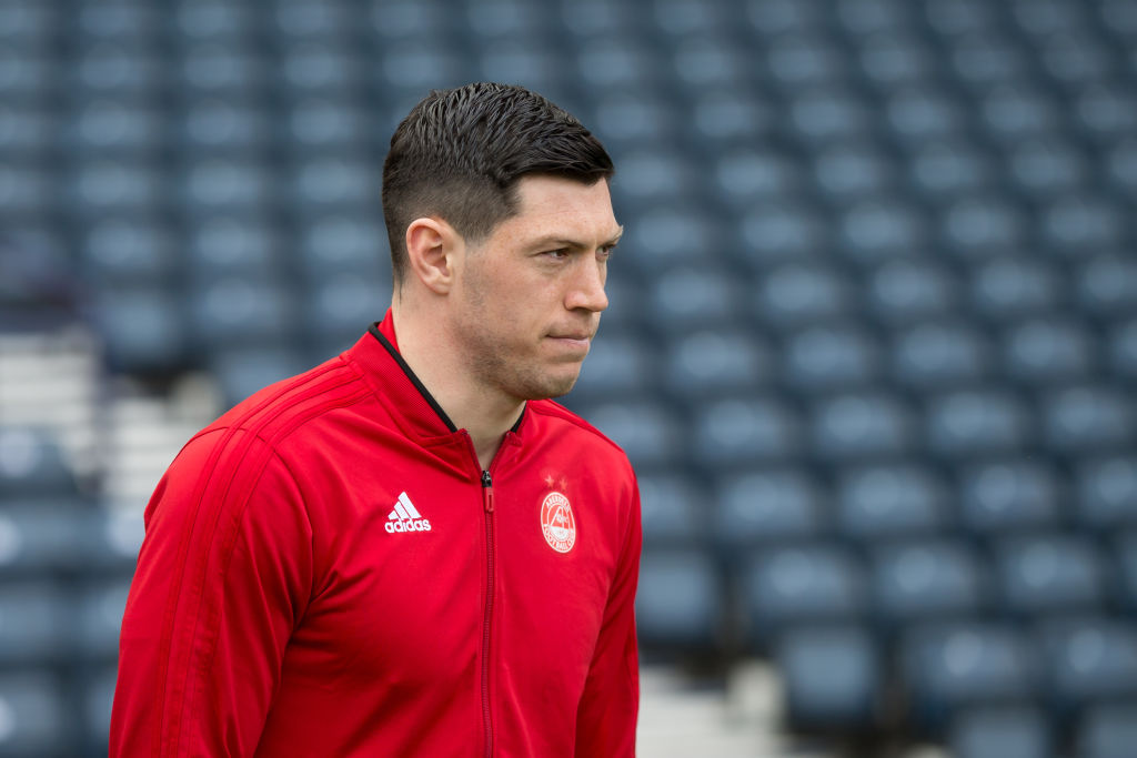 14th April 2019, Hampden Park, Glasgow, Scotland; Scottish Cup football, semi final, Aberdeen versus Celtic; Scott McKenna of Aberdeen inspects the pitch before the match