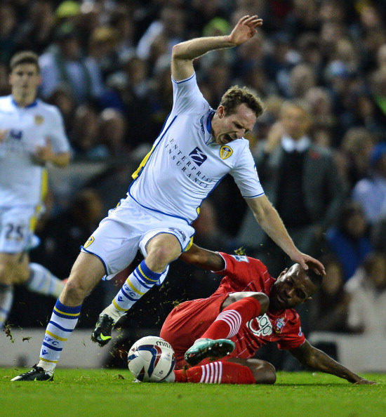 "Leeds United's English midfielder Aidy White (L) vies with Southampton's Brazilian striker Guly do Prado (R) during the English League Cup Fourth Round football match between Leeds United and Southampton at Elland Road in Leeds, northern England on October 30, 2012. AFP PHOTO/ANDREW YATES RESTRICTED TO EDITORIAL USE. No use with unauthorized audio, video, data, fixture lists, club/league logos or ""live"" services. Online in-match use limited to 45 images, no video emulation. No use in betting, games or single club/league/player publications"