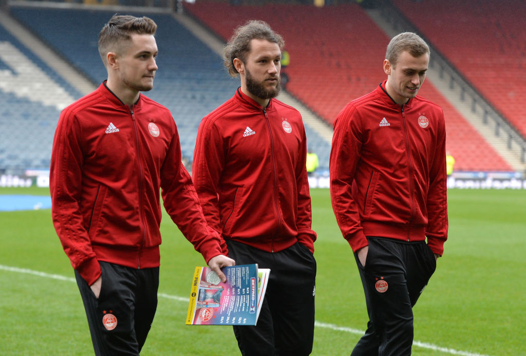 GLASGOW, SCOTLAND - DECEMBER 02: (L-R) Scott Wright, Stevie May and James Wilson of Aberdeen walk on the pitch prior to the Betfred Cup Final between Celtic and Aberdeen at Hampden Park on December 2, 2018 in Glasgow, Scotland.