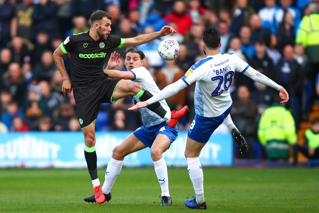 BIRKENHEAD, ENGLAND - MAY 10: Christian Doidge of Forest Green Rovers and Oliver Banks of Tranmere Rovers during the Sky Bet League Two Play-off Semi Final First Leg match between Tranmere Rovers and Forest Green at Prenton Park on May 9, 2019 in Birkenhead, United Kingdom.