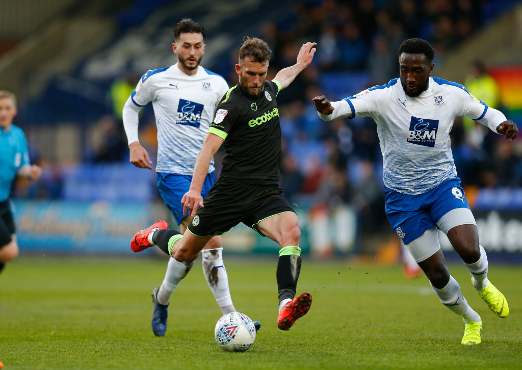 10th May 2019, Prenton Park, Tranmere, England; EFL League two football, playoff semi final 1st leg, Tranmere Rovers versus Forest Green Rovers; Christian Doidge of Forest Green Rovers shoots from the edge of the Tranmere Rovers area as Emmanuel Monthe and Oliver Banks challenge