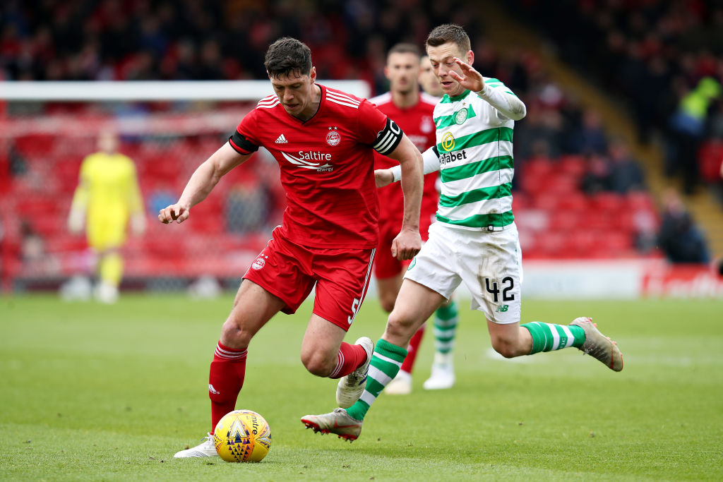 ABERDEEN, SCOTLAND - MAY 04: Scott McKenna of Aberdeen is challenged by Callum McGregor of Celtic during the Ladbrokes Scottish Premiership match between Aberdeen and Celtic at Pittodrie Stadium on May 04, 2019 in Aberdeen, Scotland.