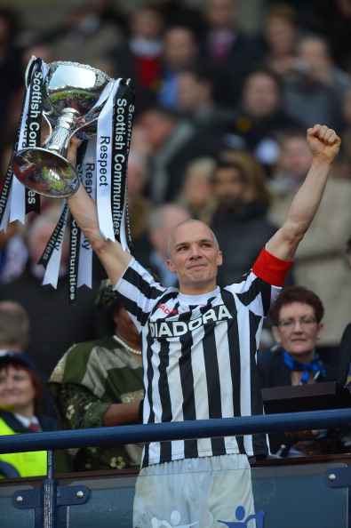GLASGOW, UNITED KINGDOM - MARCH 17: Jim Goodwin of St Mirren celebrates with the Scottish Communities League Cup after victory in the Scottish Communities League Cup Final between St Mirren and Hearts at Hampden Park on March 17, 2013 in Glasgow, Scotland.