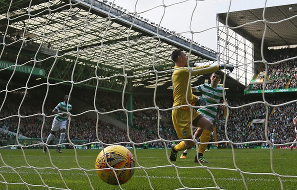 GLASGOW, SCOTLAND - SEPTEMBER 30: Ross Laidlaw of Hibernian is seen as Tomas Rogic of Celtic looks on after Callum McGregor of Celtic scores the opening goal during the Ladbrokes Scottish Premiership match between Celtic and Hibernian at Celtic Park Stadium on September 30, 2017 in Glasgow, Scotland.