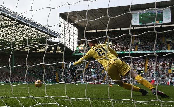 GLASGOW, SCOTLAND - SEPTEMBER 30: Ross Laidlaw of Hibernian is beaten as Callum McGregor of Celtic scores the opening goal during the Ladbrokes Scottish Premiership match between Celtic and Hibernian at Celtic Park Stadium on September 30, 2017 in Glasgow, Scotland.