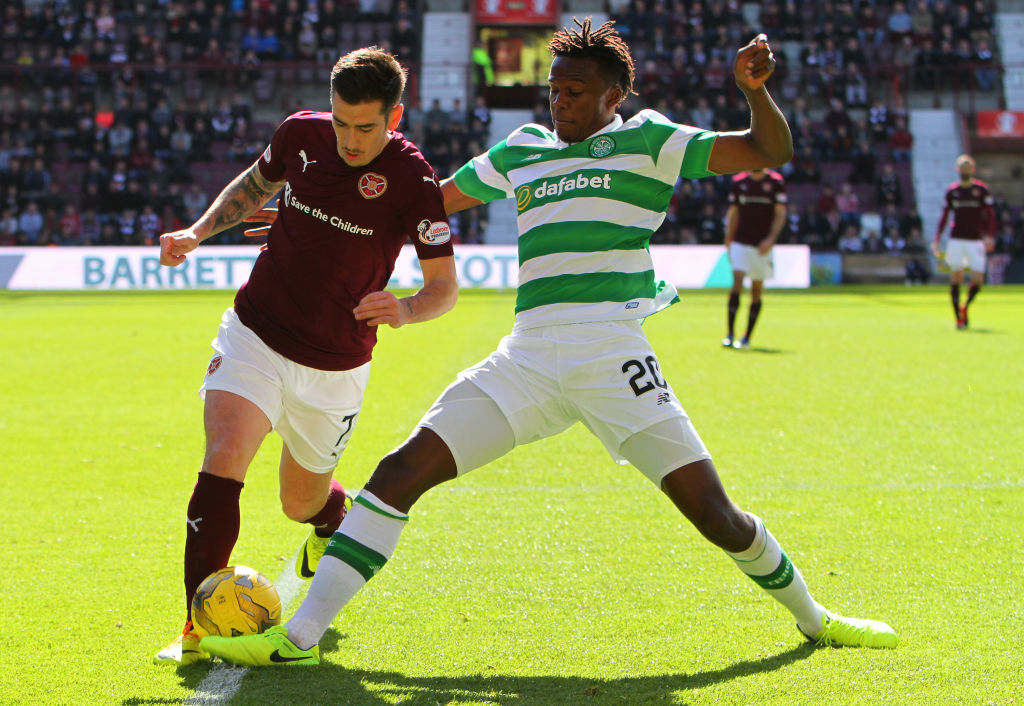 April 2nd 2017, Tynecastle, Edinburgh, Scotland, SPL Scottish premier League football, Hearts versus Celtic; Celtic's Dedryck Boyata nicks the ball away from Jamie Walker