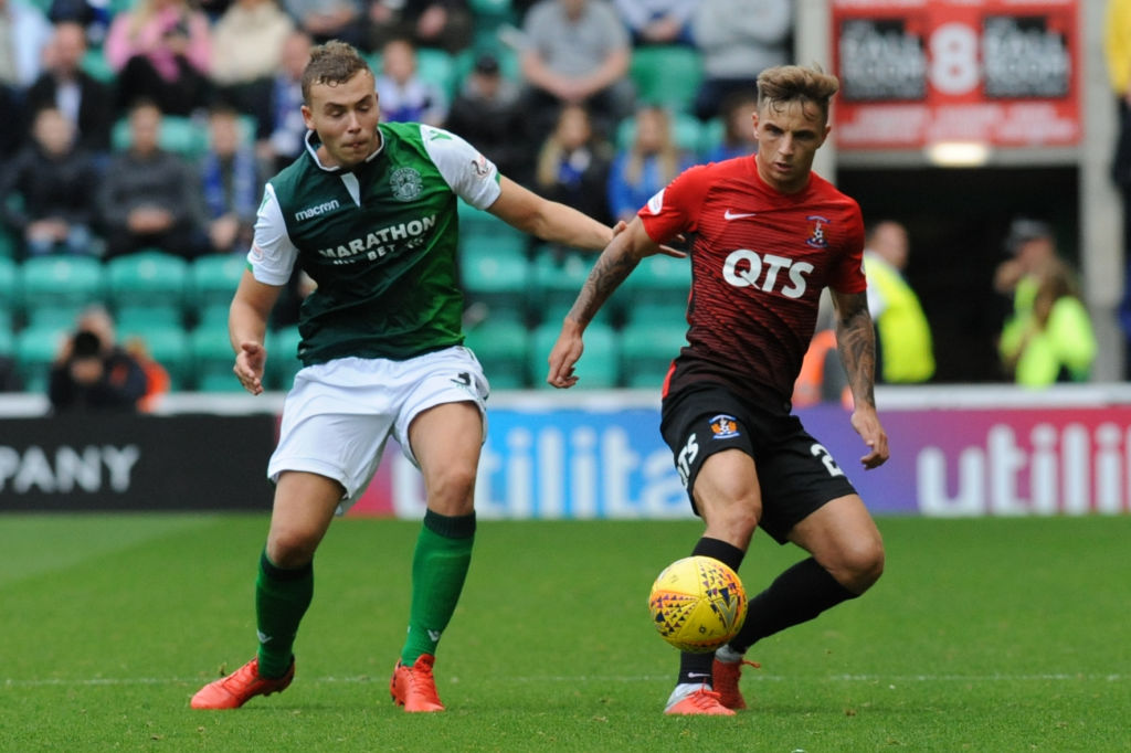 EDINBURGH, SCOTLAND - SEPTEMBER 15: Ryan Porteous of Hibernian FC goes up against Eamonn Brophy (R) of Kilmarnock FC during the Scottish Ladbrokes Premiership match between Hibernian and Kilmarnock at Easter Road on September 15, 2018 in Edinburgh, United Kingdom.