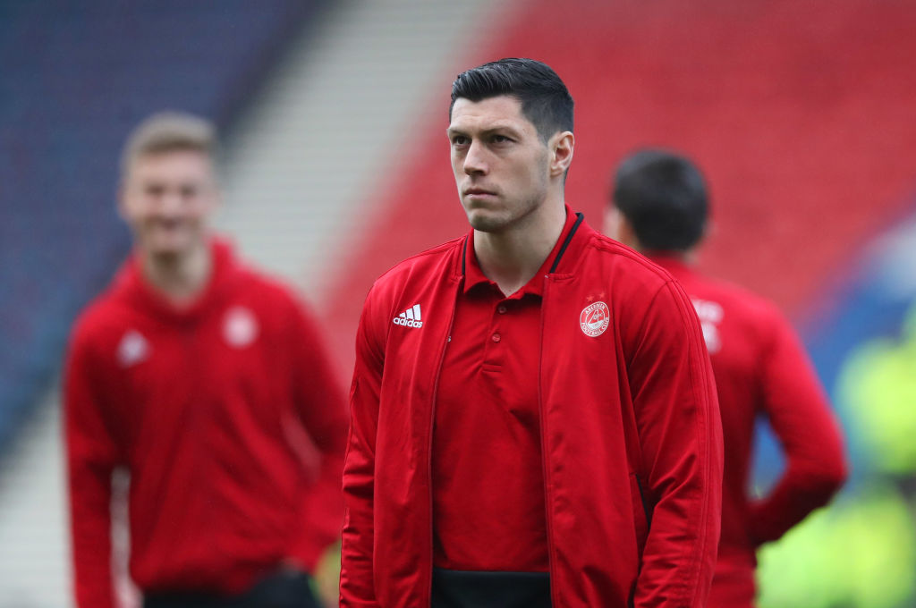 GLASGOW, SCOTLAND - DECEMBER 02: Scott McKenna of Aberdeen walks on the pitch with team mates prior to the Betfred Cup Final between Celtic and Aberdeen at Hampden Park on December 2, 2018 in Glasgow, Scotland.