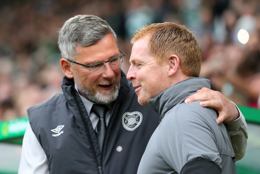 GLASGOW, SCOTLAND - MAY 19: Craig Levein, manager of Hearts and Neil Lennon, Interim manager of Celtic on discussion prior to the Ladbrokes Scottish Premiership match between Celtic and Hearts at Celtic Park on May 19, 2019 in Glasgow, Scotland.
