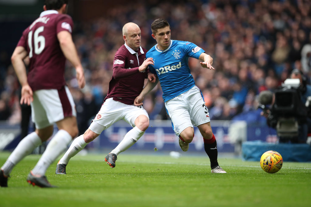 GLASGOW, SCOTLAND - APRIL 22: Steven Naismith of Heart of Midlothian vies with Declan John of Rangers during the Ladbrokes Scottish Premiership match between Rangers and Hearts at Ibrox Stadium on April 22, 2018 in Glasgow, Scotland.