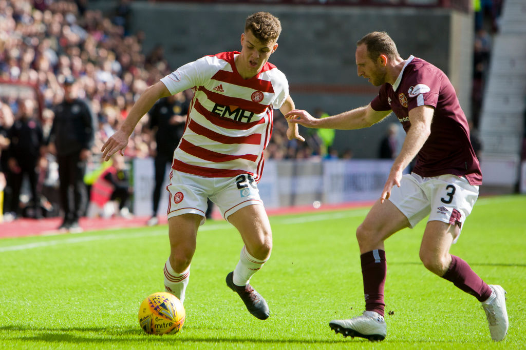 Lewis Smith of Hamilton and Aidan White of Hearts compete for the ball during the Scottish Premier League match between Hearts and Hamilton at Tynecastle park on 31 August, 2019 in Edinburgh, Scotland.