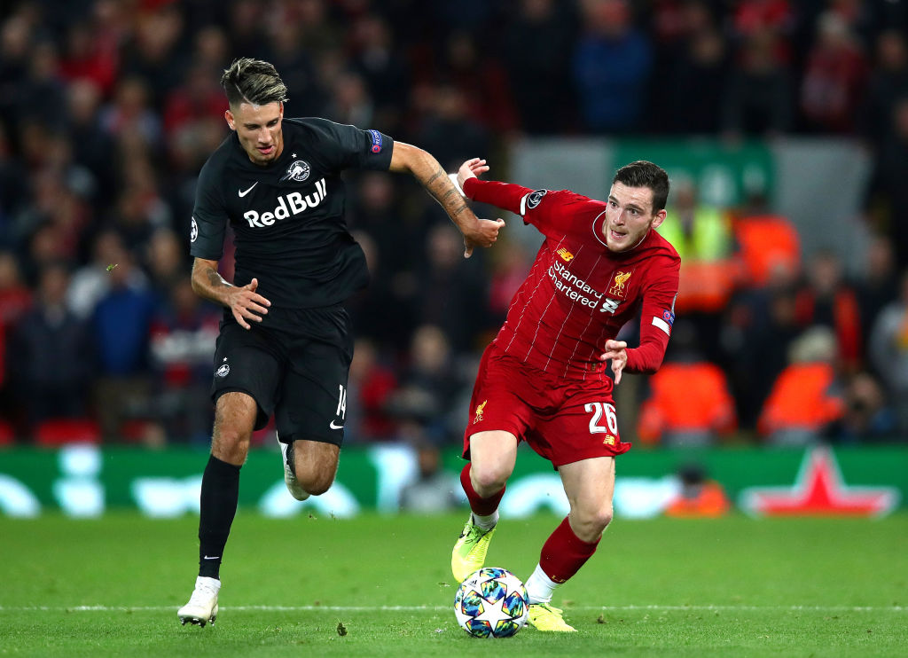 Watch as Robertson scores for Liverpool.