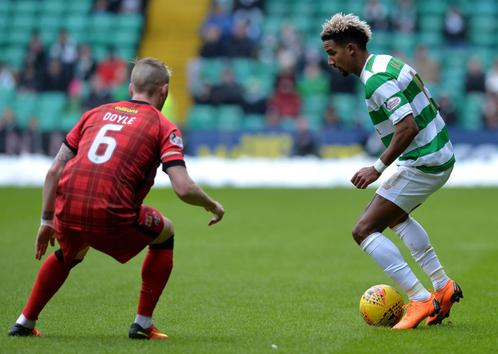 GLASGOW, SCOTLAND - MARCH 03: Scott Sinclair of Celtic is tracked by Michael Doyle of Greenock Morton during the Scottish Cup Quarter Final match between Celtic and Greenock Morton at Celtic Park on March 3, 2018 in Glasgow, Scotland.
