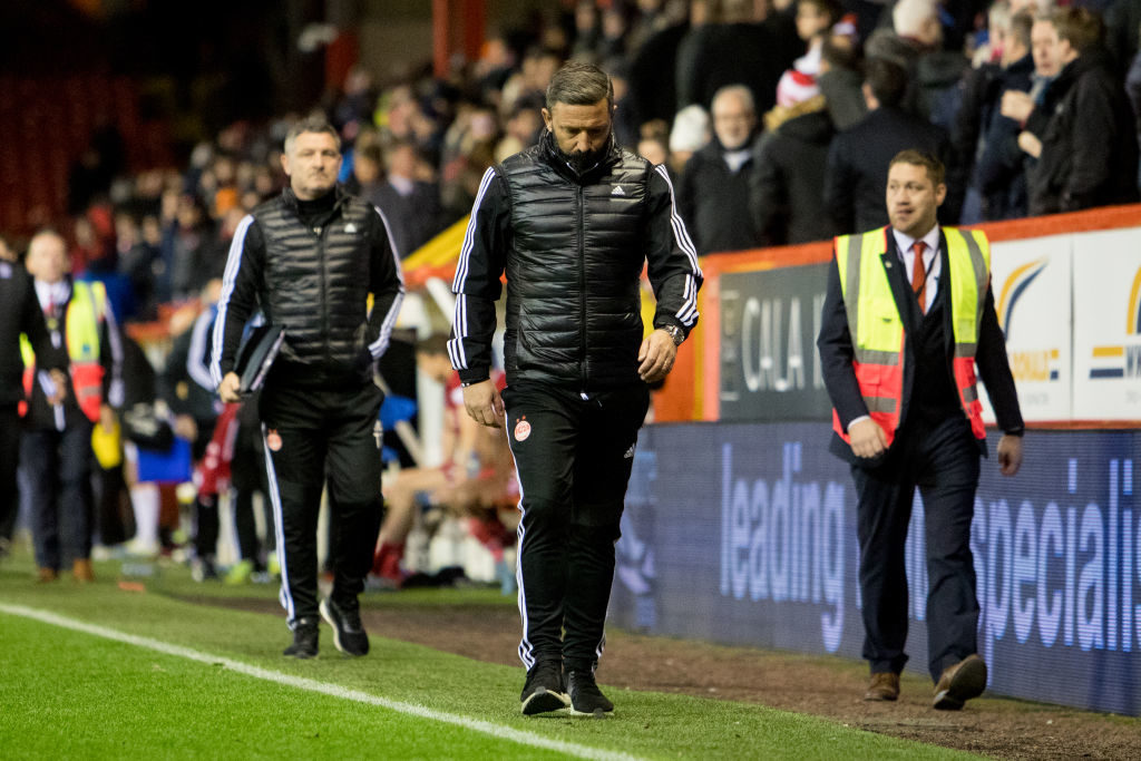 McInnes reacts to some Aberdeen fans chanting for his exit