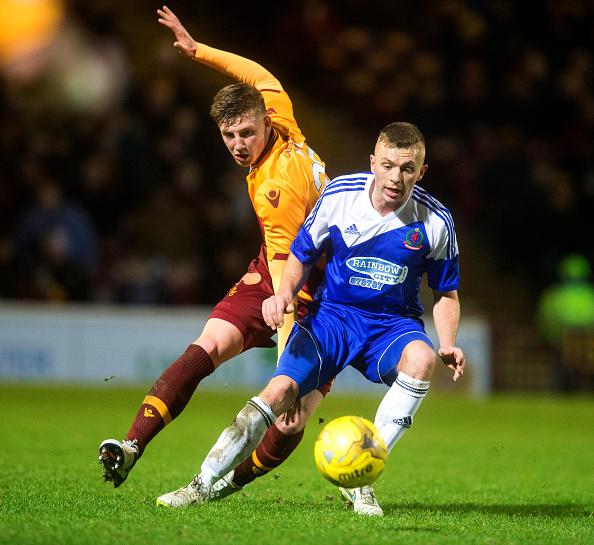 Falkirk announce the signing of former Motherwell defender