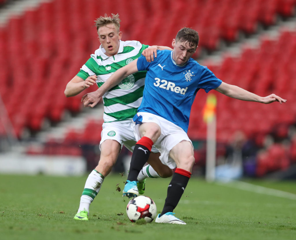 GLASGOW, SCOTLAND - APRIL 26: Calvin Miller of Celtic vies Jordan Houston of Rangers during The Scottish FA Youth Cup Final between Celtic and Rangers at Hampden Park on April 26, 2017 in Glasgow, Scotland.