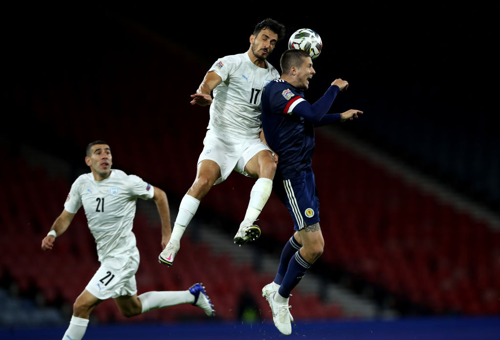 GLASGOW, SCOTLAND - SEPTEMBER 04: Hatem Elhamed of Israel is challenged by Lyndon Dykes of Scotland during the UEFA Nations League group stage match between Scotland and Israel at Hampden Park National Stadium on September 04, 2020 in Glasgow, Scotland.