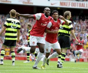 Arsenal's Carlos Vela (R) celebrates sco