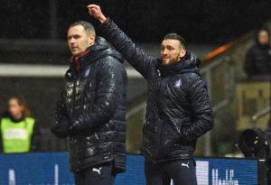 Lee Miller and David McCracken watch Falkirk in action