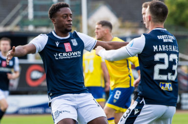Jonathan Afolabi celebrates scoring for Dundee