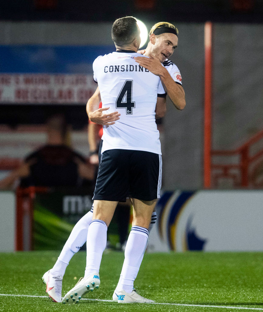 Ryan Hedges is congratulated by Andy Considine