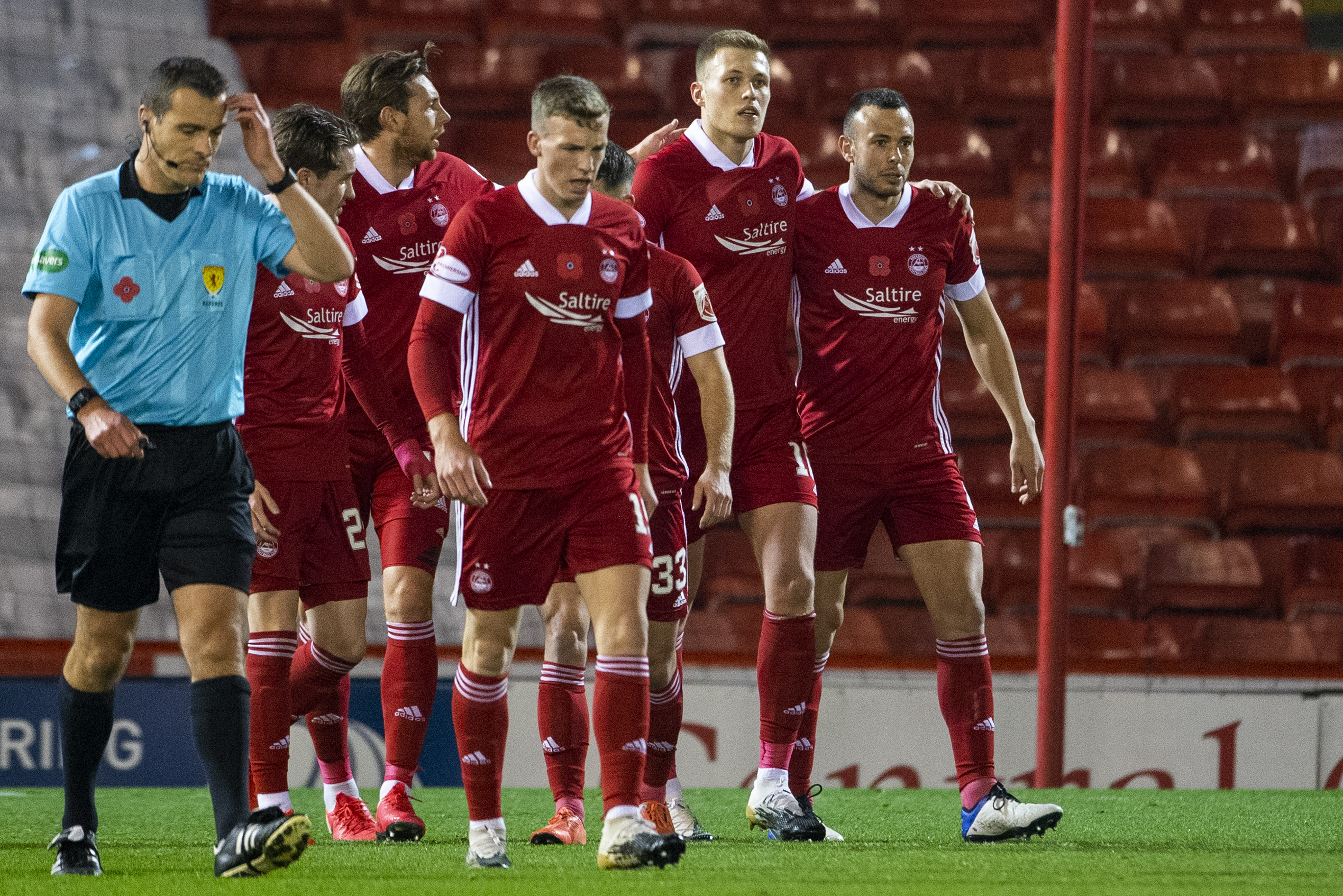 Aberdeen players in action against Hibernian