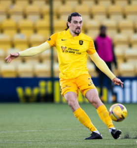 Ciaron Brown clears the ball for Livingston