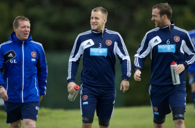 02/08/12.HEARTS TRAINING.RICCARTON - EDINBURGH.Hearts coach Gary Locke (left) chats with Danny Grainger and Andy Webster (right)