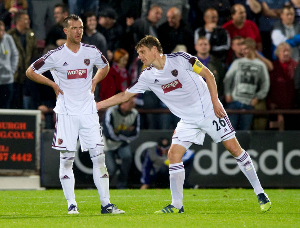 23/08/12 UEFA EUROPA LEAGUE PLAY-OFF 1ST LEG.HEARTS v LIVERPOOL.TYNECASTLE - EDINBURGH.Hearts captain Marius Zaliukas (right) gives encouragement to team-mate Andy Webster after his own goal