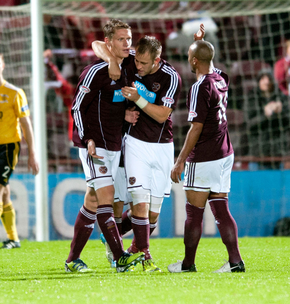 25/09/12 SCOTTISH COMMUNITIES LEAGUE CUP 3RD RND.HEARTS v LIVINGSTON (3-1).TYNECASTLE - EDINBURGH.Hearts' Marius Zaliukas (left) is hailed by fellow scorer Danny Grainger after putting the home side back in front
