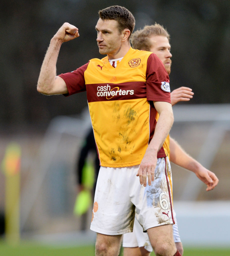 15/02/14 SCOTTISH PREMIERSHIP.MOTHERWELL v PARTICK THISTLE.FIR PARK - MOTHERWELL.Motherwell's Stephen McManus celebrates at full-time