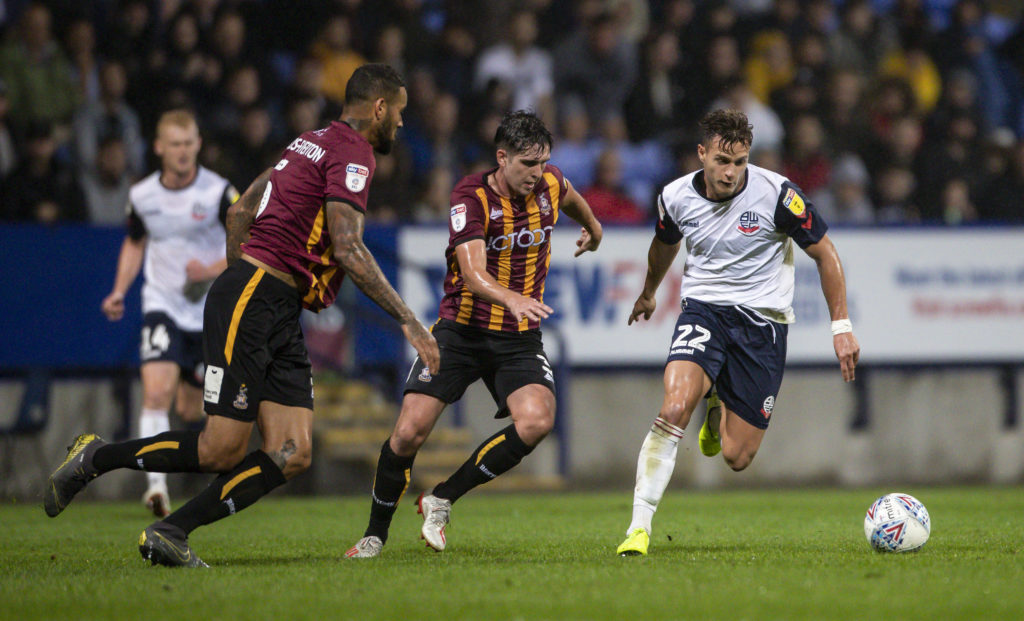 Former Bradford City star returns to Premiership side after three years; manager is 'delighted'