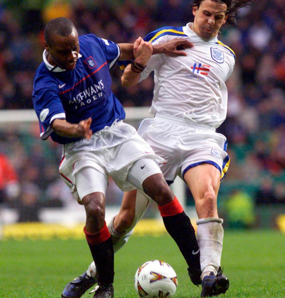 11/04/99 Tennent'S Scottish Cup Semi-Final.St Johnstone V Rangers (0-4).Celtic Park - Glasgow.Rangers Striker Rod Wallace (Left) Battles For Possession With Nick Dasovic.