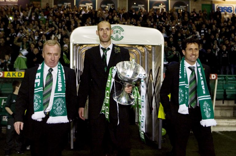 18/03/07 .Easter Road - Edinburgh .Hibs Manager John Collins (Right) And Assistant Tommy Craig Flank Captain Rob Jones As They Emerge With The Cis Insurance Cup