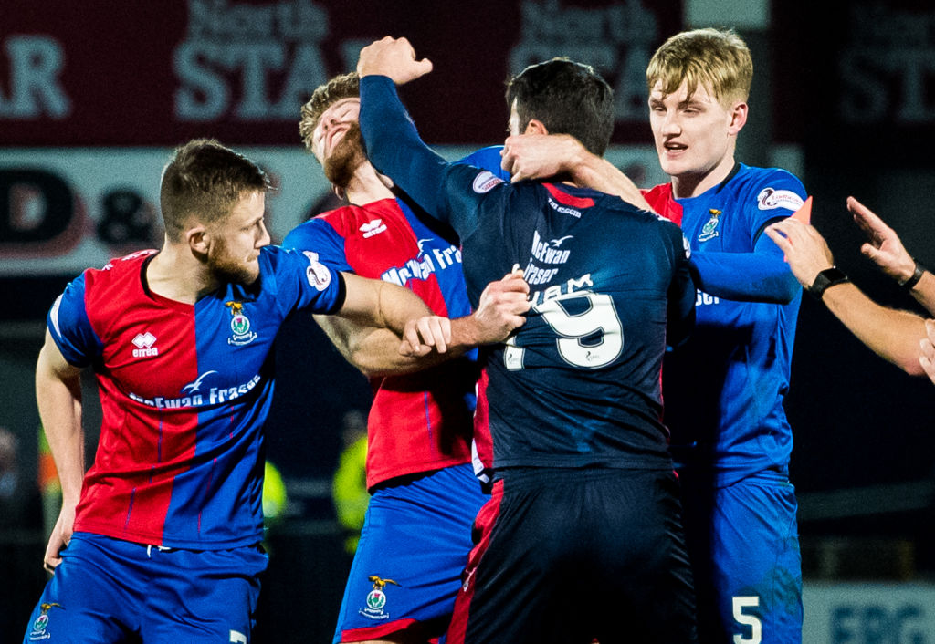 29/12/18 LADBROKES CHAMPIONSHIP.ROSS COUNTY VS INVERNESS CT.THE GLOBAL ENERGY STADIUM-DINGWALL.Ross County's Brian Graham (right) is sent off after throwing a punch at Inverness CT's Shaun Rooney.