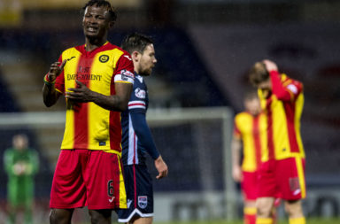 03/04/18 LADBROKES PREMIERSHIP .ROSS COUNTY V PARTICK THISTLE.GLOBAL ENERGY STADIUM - DINGWALL.Partick Thistle's Abdul Osman (left) is dejected.