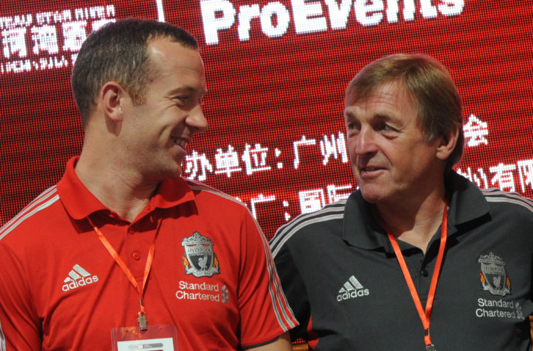 Liverpool FC player Charlie Adam (L) and